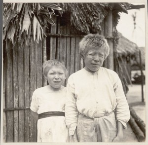 Cuna Girl and Boy Albinos Outside Pole House 1923